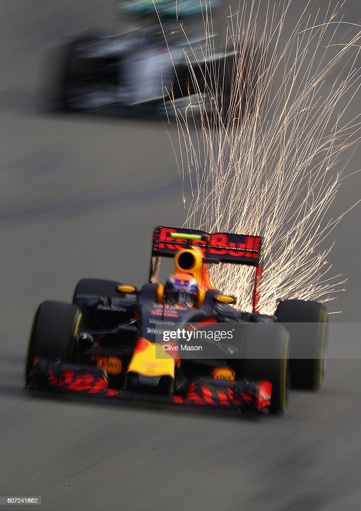 Sparks fly behind Max Verstappen of the Netherlands driving the (33) Red Bull Racing Red Bull-TAG Heuer RB12 TAG Heuer on track during final practice for the Formula One Grand Prix of Singapore at Marina Bay Street Circuit on September 17, 2016 in Singapore.