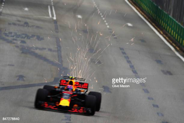 Sparks fly behind Max Verstappen of the Netherlands driving the Red Bull Racing Red BullTAG Heuer RB13 TAG Heuer on track during practice for the...