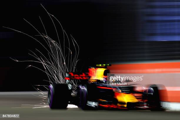 Sparks fly behind Max Verstappen of the Netherlands driving the Red Bull Racing Red BullTAG Heuer RB13 TAG Heuer on track during qualifying for the...