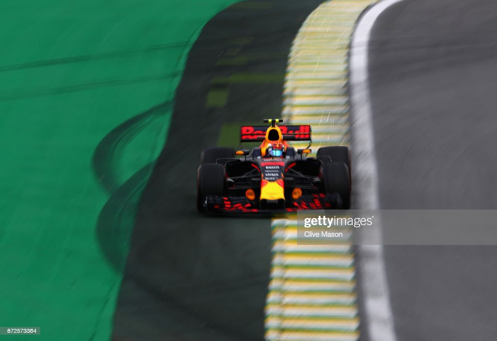 Sparks fly behind Max Verstappen of the Netherlands driving the (33) Red Bull Racing Red Bull-TAG Heuer RB13 TAG Heuer on track during practice for the Formula One Grand Prix of Brazil at Autodromo Jose Carlos Pace on November 10, 2017 in Sao Paulo, Brazil.