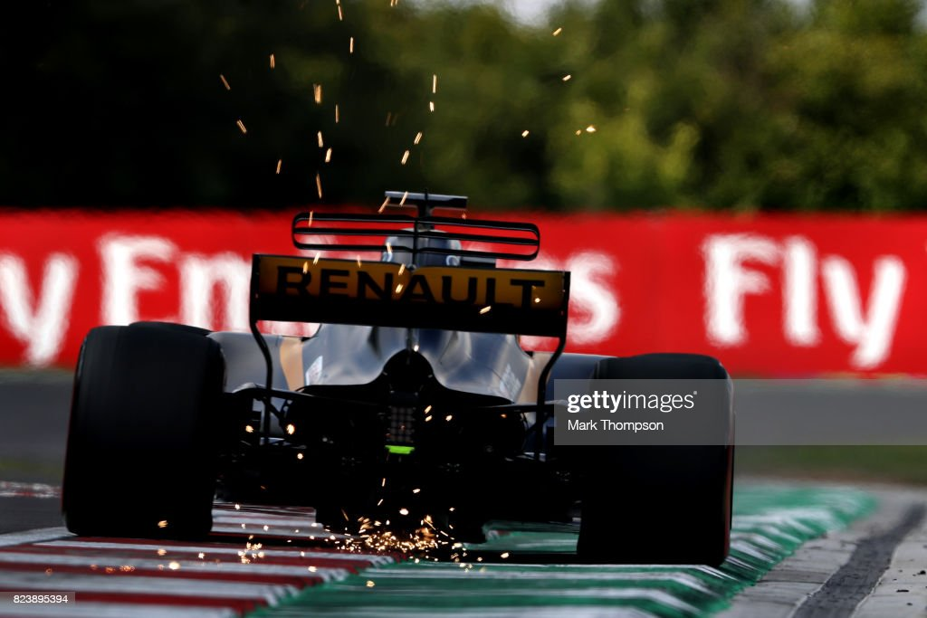 Sparks fly behind Nico Hulkenberg of Germany driving the (27) Renault Sport Formula One Team Renault RS17 on track during practice for the Formula One Grand Prix of Hungary at Hungaroring on July 28, 2017 in Budapest, Hungary.