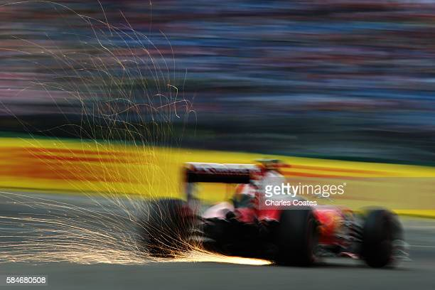 Sparks fly behind Sebastian Vettel of Germany driving the Scuderia Ferrari SF16H Ferrari 059/5 turbo on track during final practice for the Formula...