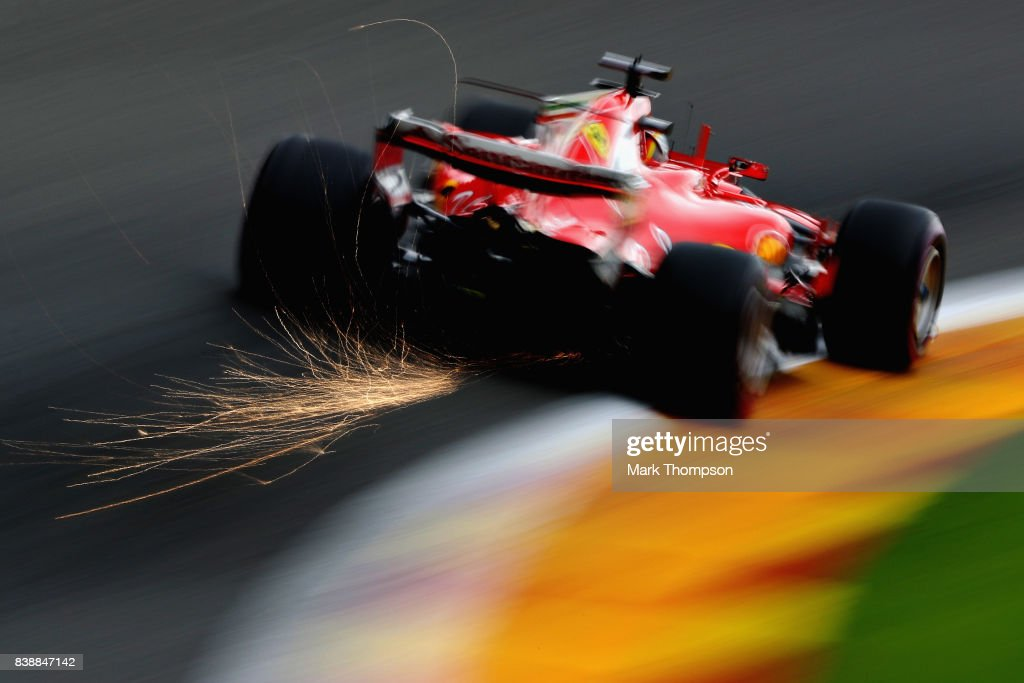 Sparks fly behind Sebastian Vettel of Germany driving the (5) Scuderia Ferrari SF70H on track during practice for the Formula One Grand Prix of Belgium at Circuit de Spa-Francorchamps on August 25, 2017 in Spa, Belgium.