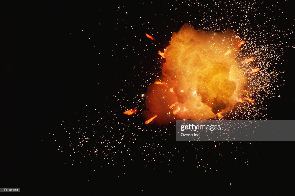 Sparks flying from explosion : Stock Photo