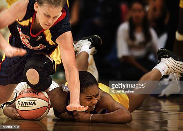 LA Sparks guard Ukari Figgs dives for a ball fumbled away by Indian Fever player Vicki Hall in the second half of Monday's WNBA game at the Staples...