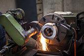 sparks through grinding wheel in grinding machine