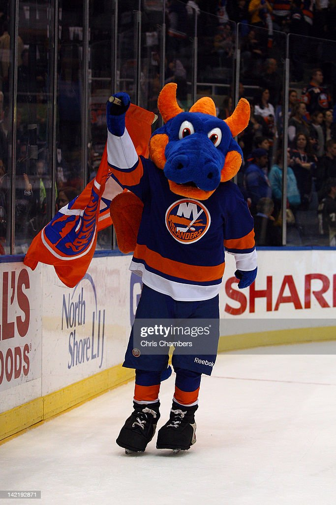 Sparky The Dragon, mascot for the New York Islanders skates against the Pittsburgh Penguins at Nassau Veterans Memorial Coliseum on March 29, 2012 in Uniondale, New York.