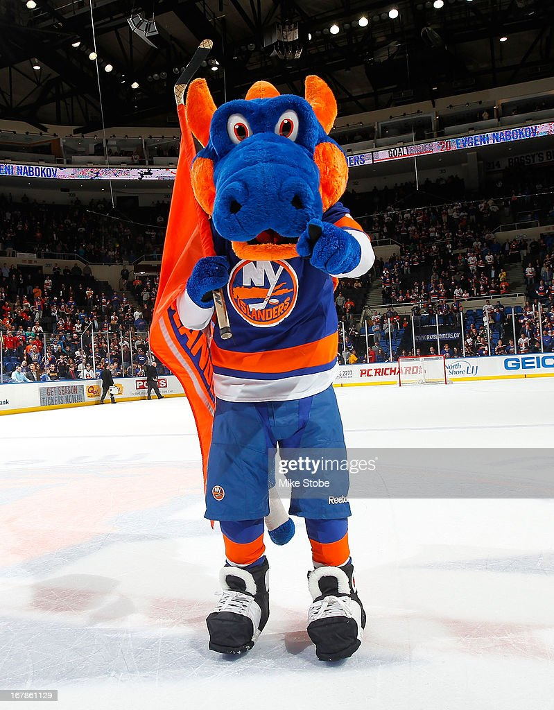 Sparky the Dragon performs during the game between the Florida Panthers and the New York Islanders at Nassau Veterans Memorial Coliseum on April 16, 2013 in Uniondale, New York.