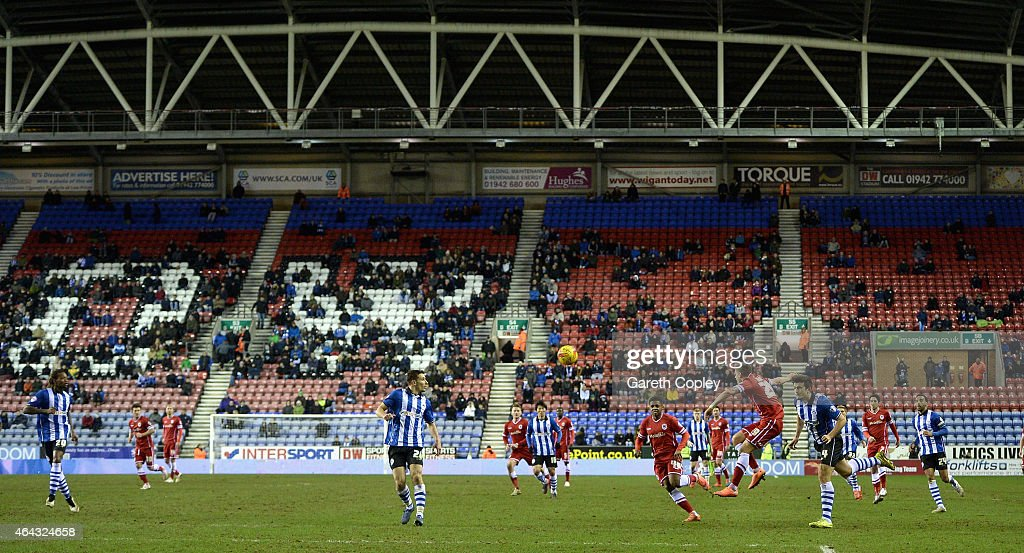 A sparse crowd play during the Sky Bet Championship match between Wigan Athletic and Cardiff City at DW Stadium on February 24 2015 in Wigan England