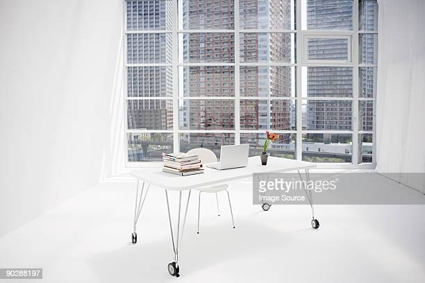 A sparse white office