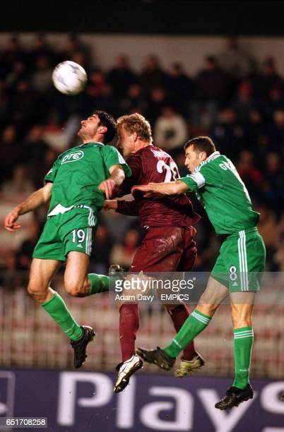 Sparta Prague's Jiro Jarosik is outnumbered as he jumps for a header with Panathinaikos's Michalis Konstantinou and Ioannis Goumas