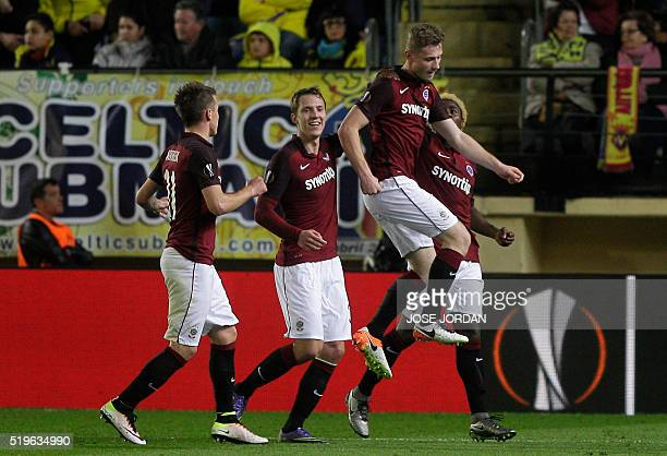 Sparta Praha's defender Jakub Brabec celebrates a goal with teammates during the UEFA Europa League quarter finals first leg football match...
