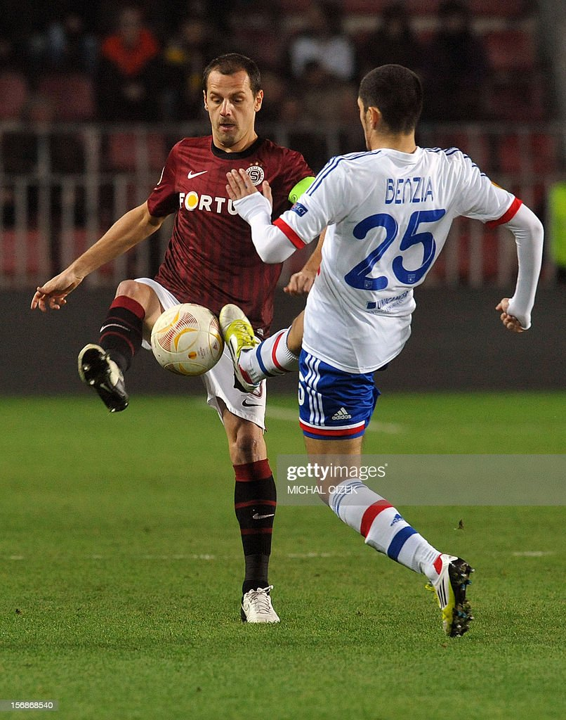 Sparta Praha's midfielder Marek Matejovsky (L) and Lyon's striker Yassine Benzia vie for the ball during the UEFA Europa League Group I football match Sparta Praha vs Lyon in Prague, Czech Republic on November 22, 2012.