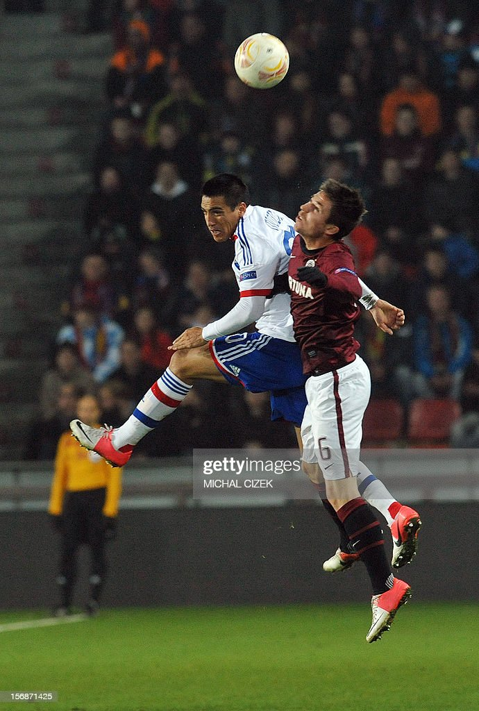 Sparta Praha's striker Tomas Prikryl (R) and Lyon's Argentinian defender Fabian Monzon vie for the ball during the UEFA Europa League Group I football match Sparta Praha vs Lyon in Prague, Czech Republic on November 22, 2012.
