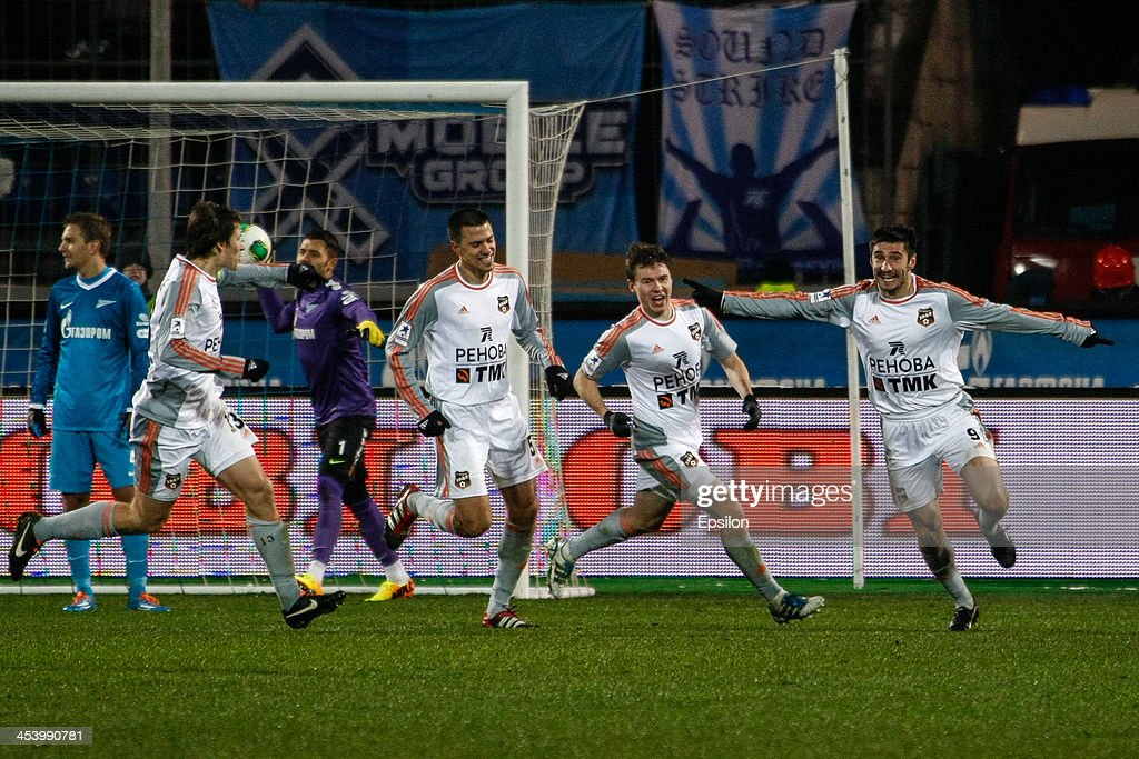 Spartak Gogniyev of FC Ural Sverdlovsk Oblast (R) celebrates his goal during the Russian Football League Championship match between FC Zenit St. Petersburg and FC Ural Sverdlovsk Oblast at the Petrovsky stadium on December 6, 2013 in St. Petersburg, Russia.