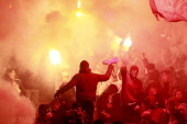 Spartak Moscow fans light flares during the Russian Premier League match between FC Spartak Moscow and FC Zenit St Petersburg at the Luzhniki Stadium...
