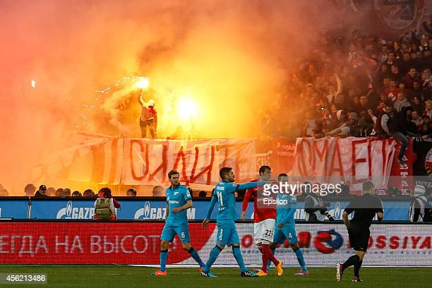 Spartak Moscow supporters light flares during the Russian Football League Championship match between FC Zenit St Petersburg and FC Spartak Moscow at...