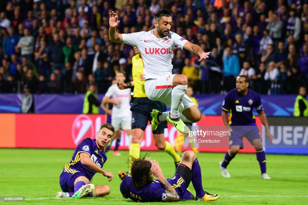 Spartak Moscow's Aleksandr Samedov (TOP) leaps over NK Maribor's Marko Suler (C) as Blaz Vrhovec (L) looks on during the UEFA Champions League Group E football match between NK Maribor and FC Spartak Moscow at The Stadium Ljudski vrt in Maribor on September 13, 2017. / AFP PHOTO / Jure Makovec