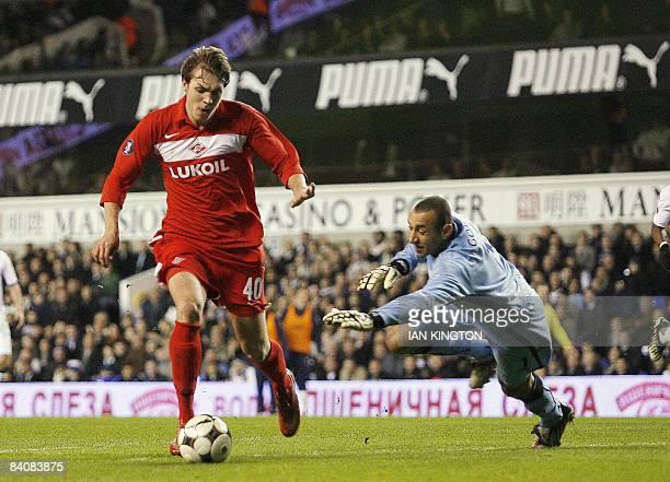 Spartak Moscow's Artem Dzuba dribbles the ball past Tottenham Hotspurs Brazilian goalkeeper Heurelho Gomes to score his second goal during a UEFA Cup...