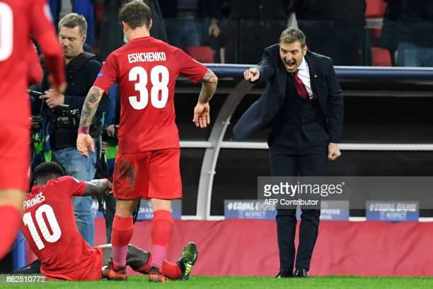 Spartak Moscow's coach from Italy Massimo Carrera reacts after Spartak Moscow's forward from Netherlands Quincy Promes scored the team's fifth goal...