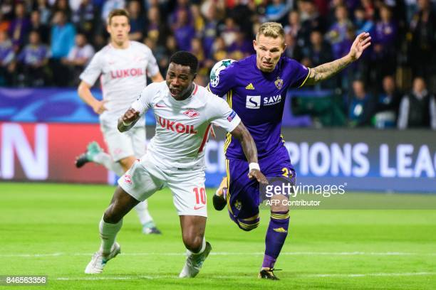 Spartak Moscow's Dutch midfielder Quincy Promes vies for the ball with NK Maribor's Slovenian defender Martin Milec during the UEFA Champions League...