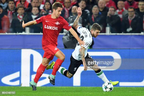 Spartak Moscow's midfielder from Croatia Mario Pasalic and Liverpool's defender from Spain Alberto Moreno vie for the ball during the UEFA Champions...
