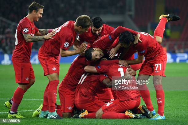 Spartak Moscow's players celebrate a goal during the UEFA Champions League Group E football match between FC Spartak Moscow and Liverpool FC at the...