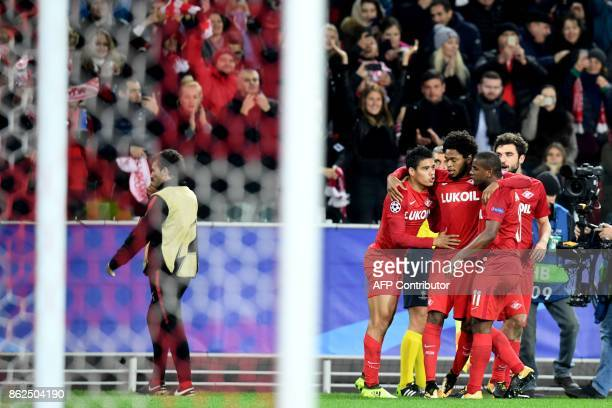 Spartak Moscow's players celebrate a goal scored by Spartak Moscow's midfielder from Paraguay Lorenzo Melgarejo during the UEFA Champions League...