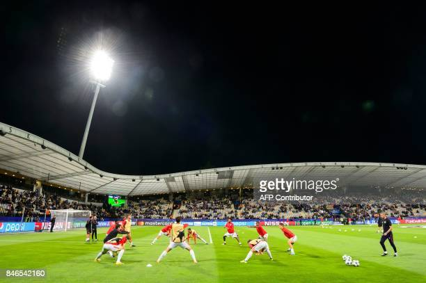 Spartak Moscow's players warm up prior to the UEFA Champions League Group E football match between NK Maribor and FC Spartak Moscow at The Stadium...