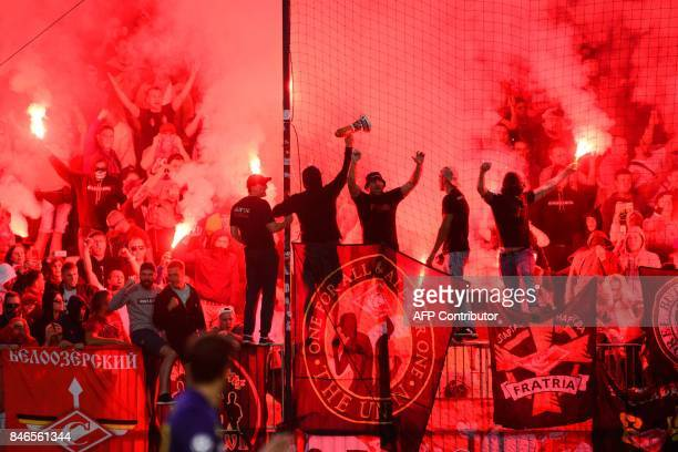Spartak Moscow's supporters burn flares during the UEFA Champions League Group E football match between NK Maribor and FC Spartak Moscow at The...