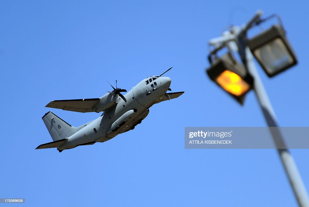 Spartan type cargo transporter of the Italian Air Force performs during the opening of the International Air Show at the Hungarian Air Force base in Kecskemet, southern Hungary, on August 3, 2013.