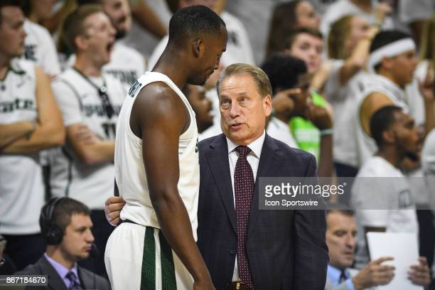 Spartans head coach Tom Izzo talks with Spartans guard Joshua Langford during an exhibition college basketball game between Michigan State and Ferris...