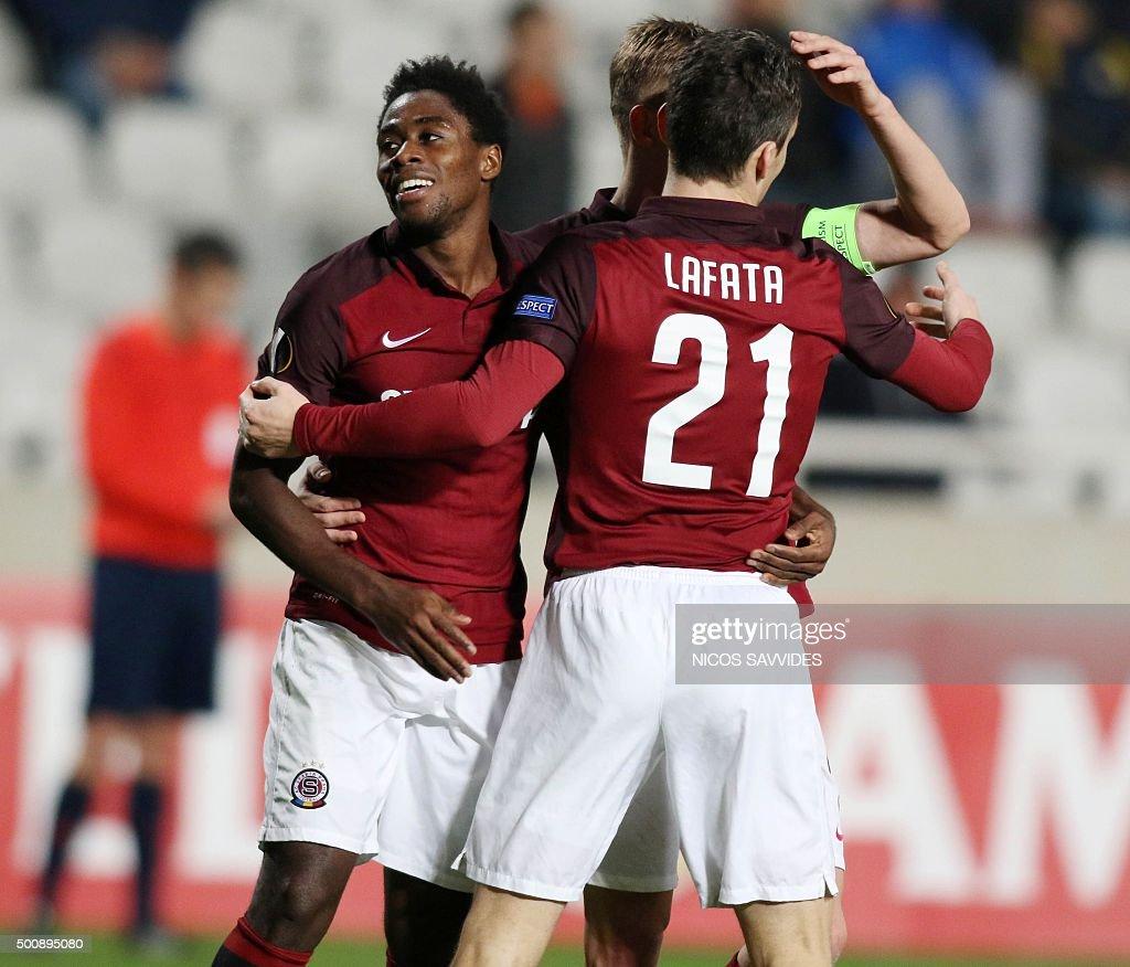 Sparta's David Lafata is congratulated by teammate Tiemoko Konate after he scored a goal during the UEFA Europa League football match Cyprus' Apoel...