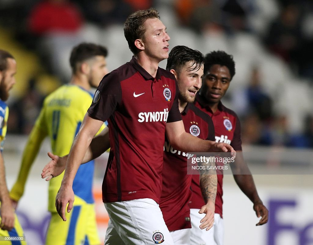 Sparta's Lukas Julis celebrates with teammates after scoring a goal during the UEFA Europa League football match Cyprus' Apoel FC versus Czech...