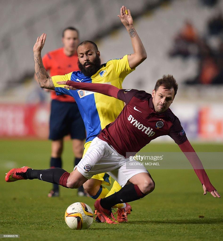 Sparta's Marek Matejosky vies with Apoel's Vander during the UEFA Europa League football match Cyprus' Apoel FC versus Czech Republic's AC Sparta...