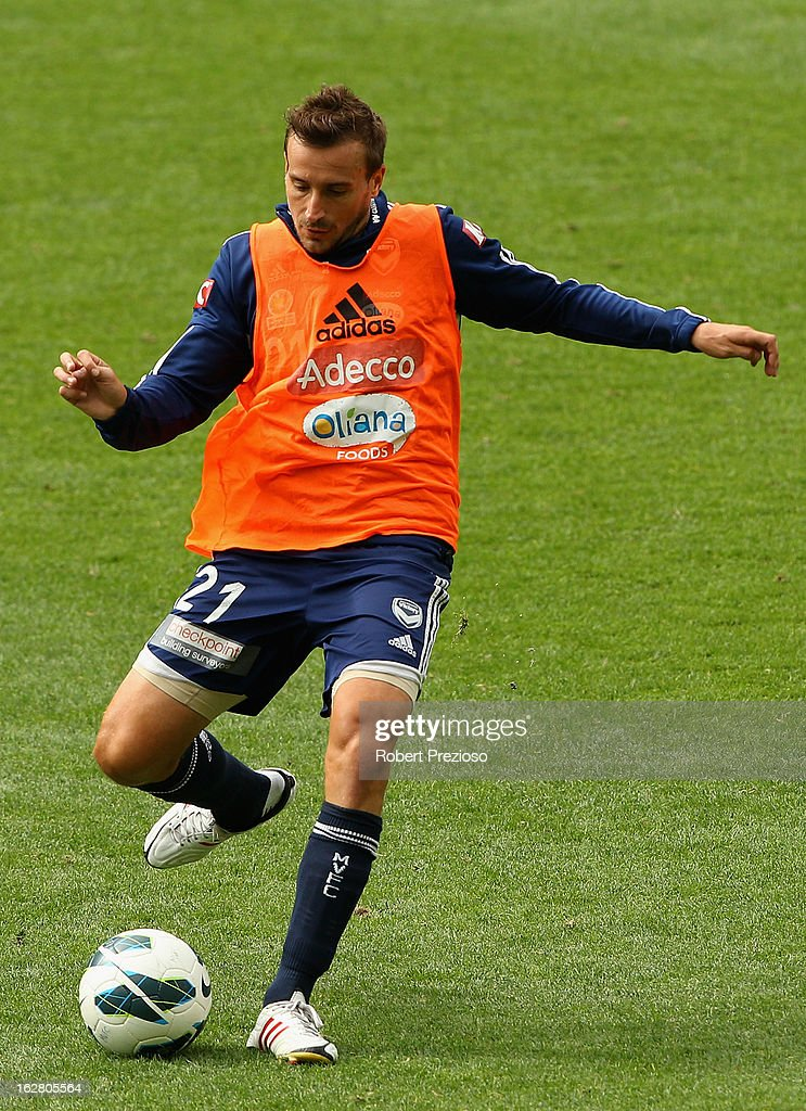 Spase Dilevski passes the ball during a Melbourne Victory A-League training session at AAMI Park on February 28, 2013 in Melbourne, Australia.