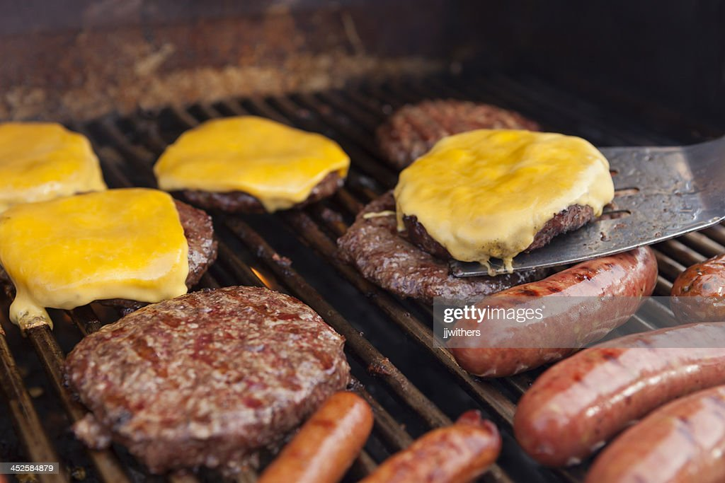Spatula with Cheeseburger on grill