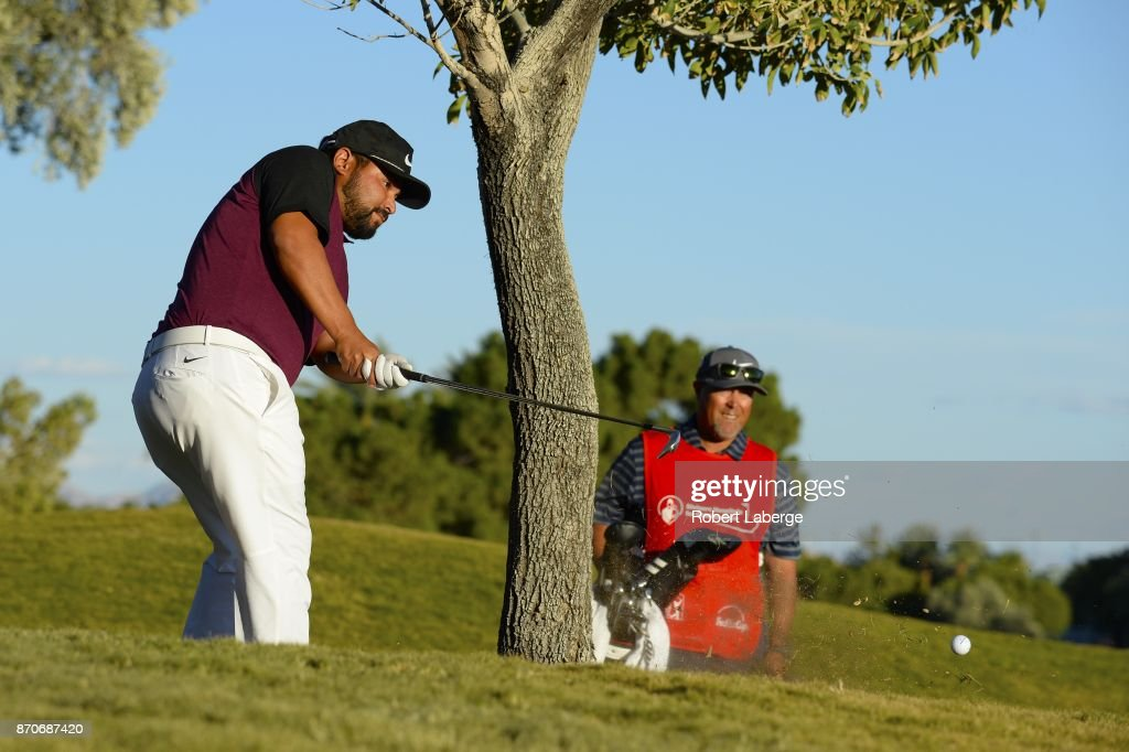 J.J. Spaun makes a shot out of the rough left handed on the 18th hole as his caddie looks on during the final round of the Shriners Hospitals For Children Open at the TPC Summerlin on November 5, 2017 in Las Vegas, Nevada.