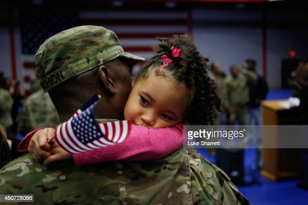 Spc Michael Fashion of the US Army's 3rd Brigade Combat Team 1st Infantry Division holds his daughter Malia Banks following a homecoming ceremony in...