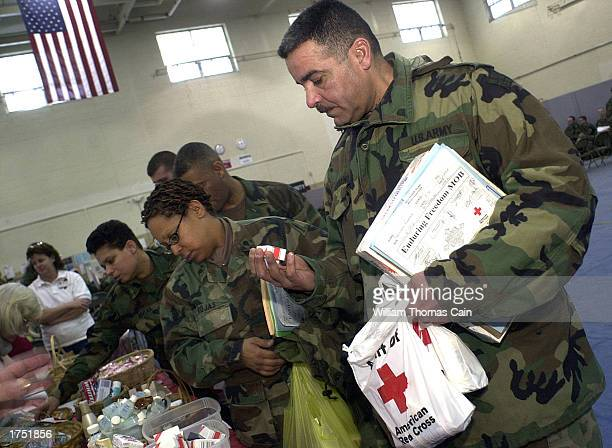 Spc Ramon Serrano of Newburgh New York with the 920 Transportation Unit receives a care kit from the Red Cross at the Fort Dix Military Reservation...
