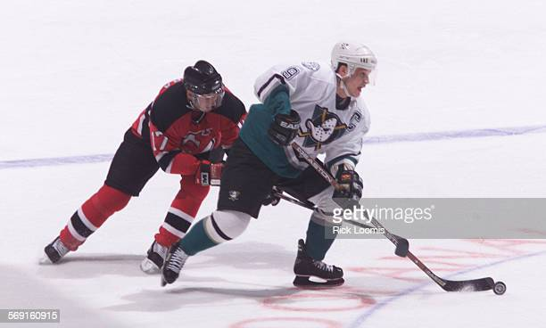 SPduckskariya0120RL––Anaheim––Mighty Ducks Paul Kariya skates away from New Jersey's Petr Sykora during the first period of play in Wednesday night's...