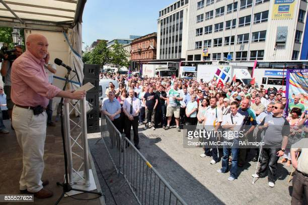 A speaker addresses a rally at the City Hall in Belfast today during a protest at the sectarian murder of Catholic community worker Kevin McDaid