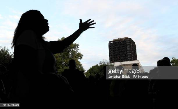 A speaker addresses marchers who took part in a silent procession to pay respect to those killed in the Grenfell Tower disaster after it finished...