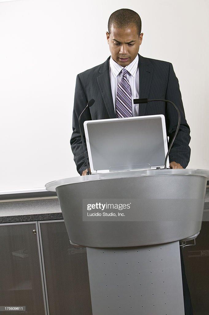Speaker at a podium : Stock Photo