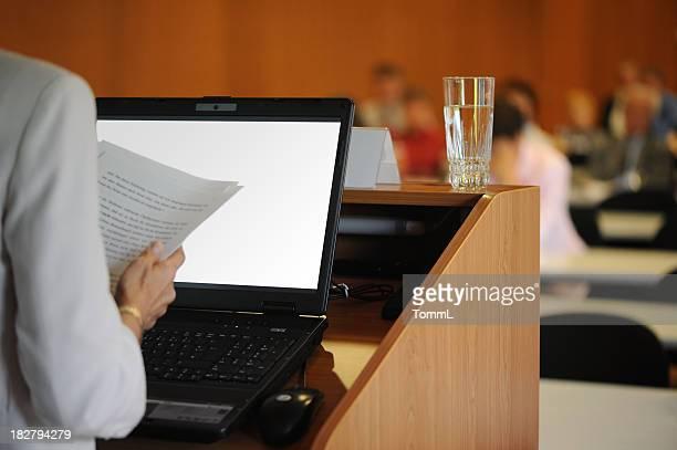 Speaker behind lectern