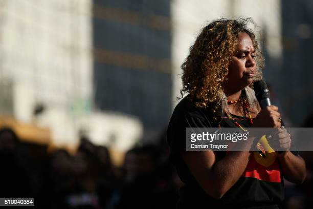 A speaker entertains the crowd as they sit down at the intersection of Flinders Street and Swanston Street during the 2017 NAIDOC March on July 7...