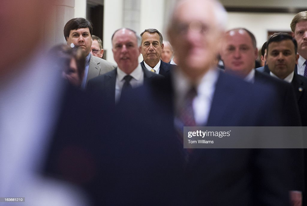 Speaker John Boehner, R-Ohio, center, makes his way to his weekly news conference in the Capitol Visitor Center.