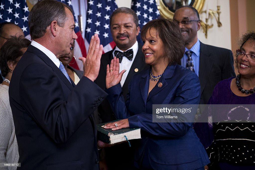 Speaker John Boehner, R-Ohio, conducts a swearing-in ceremony with Rep. Robin Kelly, D-Ill., in the Capitol on the day she was sworn in on the House floor. Kelly won a special election to replace former Rep. Jesse Jackson Jr., D-Ill.