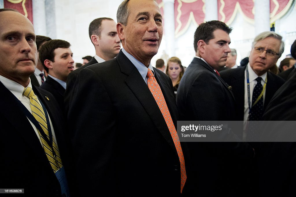 Speaker John Boehner, R-Ohio, makes his way through Statuary Hall after President Barack Obama delivered his State of the Union address to Congress in the House chamber.