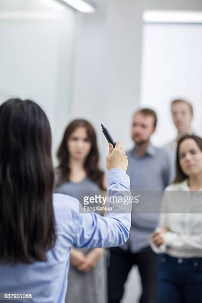 Speaker leading meeting in conference room